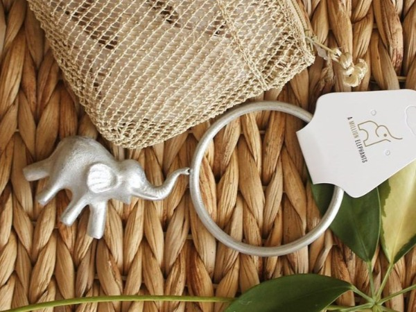 A Million Elephants bracelet bag little elephant statue 1